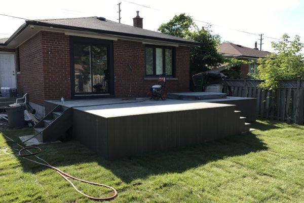 finished deck hot tub and sod
